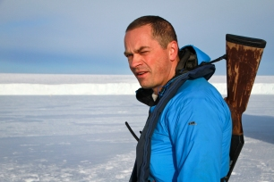 "Martin, the captain on the ice - polarbear sleeping 500m away ""If he stands up it's 200m.."""